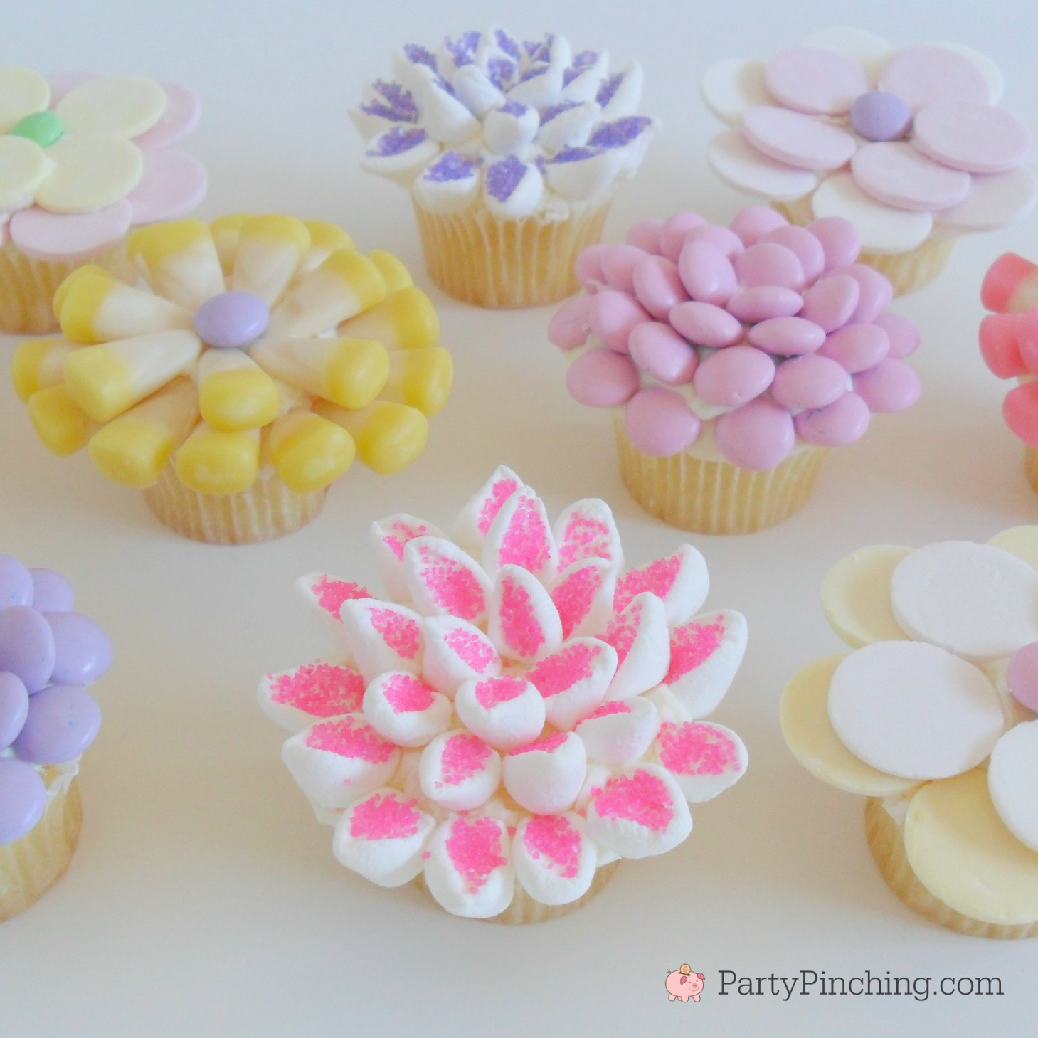 Spring flower cupcakes, easy mini cupcakes for Easter, candy decorated cupcakes, M&M marshmallow candy Necco, candy corn cupcakes, fun food for kids, sweet treats