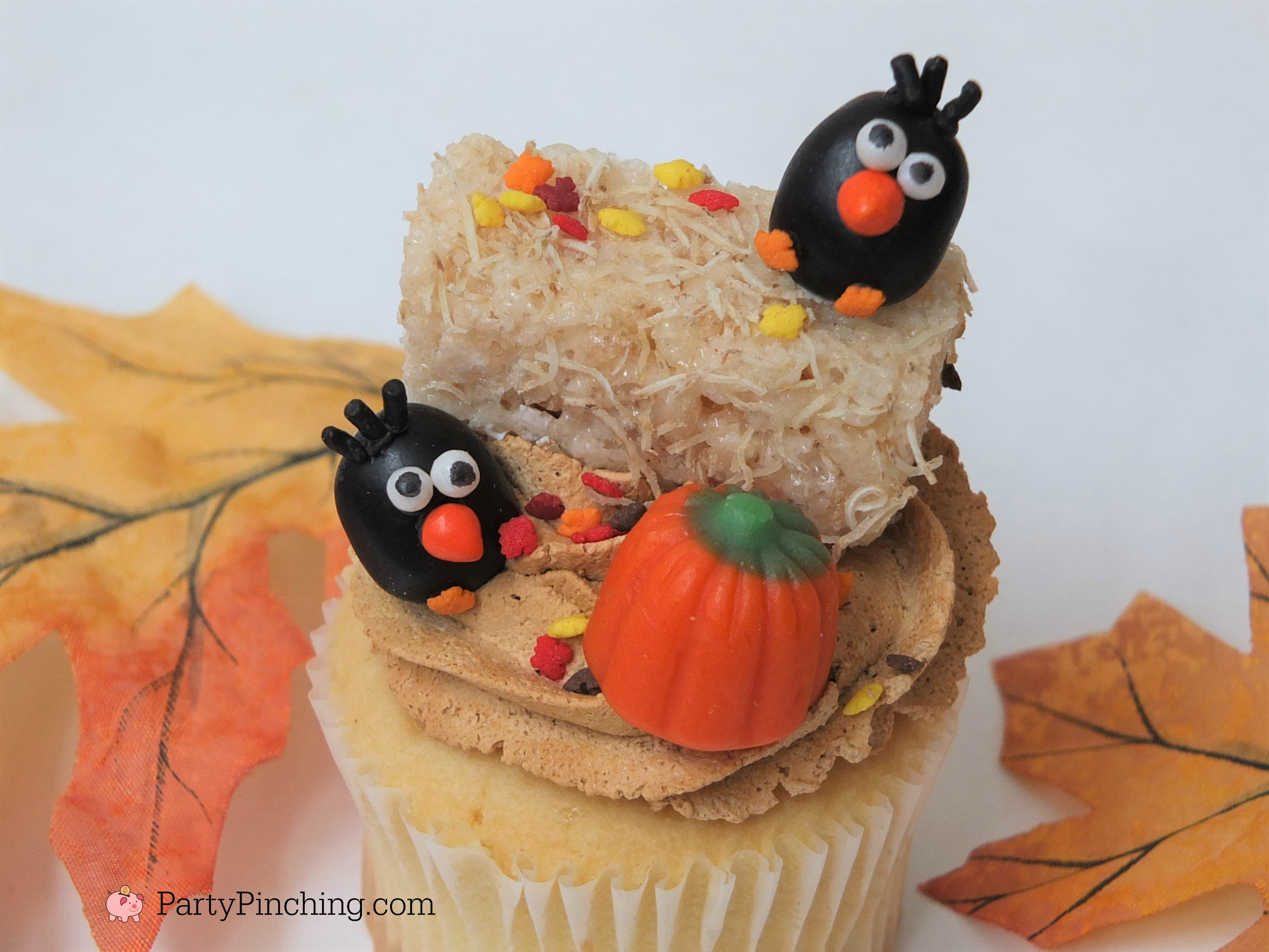 crow cupcakes, adorable autumn fall cupcakes, jelly bean crows, cute food, fun food for kids, hay bale cupcakes rice krispie haybales with leaf sprinkles, ask for whipped, caramel whipped icing frosting, harvest party ideas, thanksgiving cute dessert