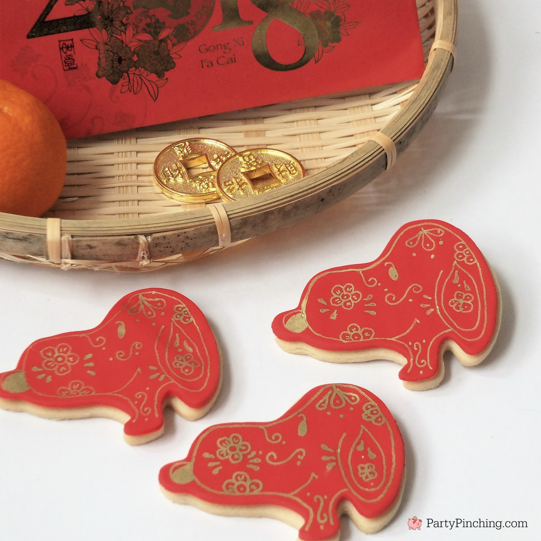 Lunar New Year, Chinese New Year, Year of the Dog, Snoopy cookies, Peanuts Cookies, Red and gold cookies, dessert ideas for Chinese New Year, Dog cookies, pretty celebration cookies, painted cookies