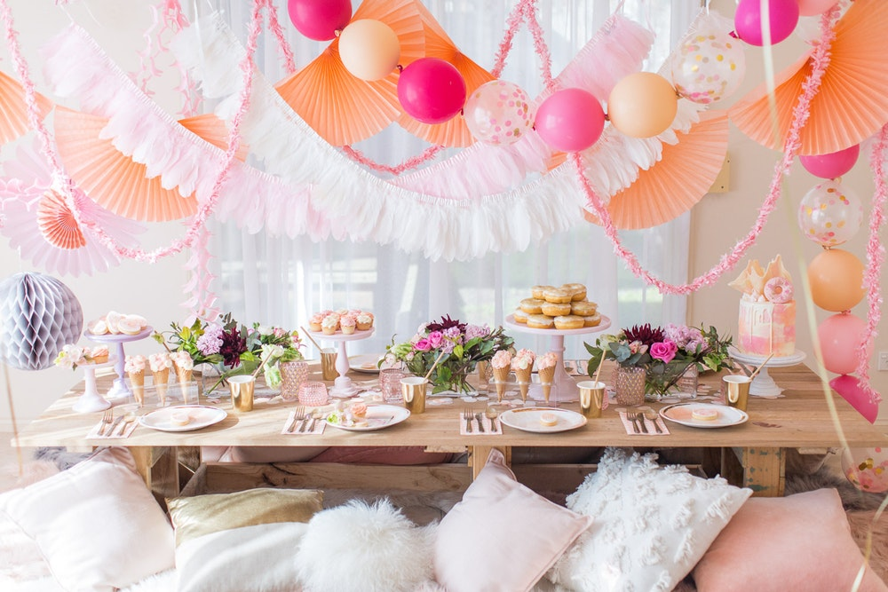 boho slumber party, peach pinch and white slumber party, pretty girl's party, glamping party, gorgeous slumber party, slumber party ideas, pink peach white party tassel feather garland, fabric teepee tent slumber party, sleepover ideas