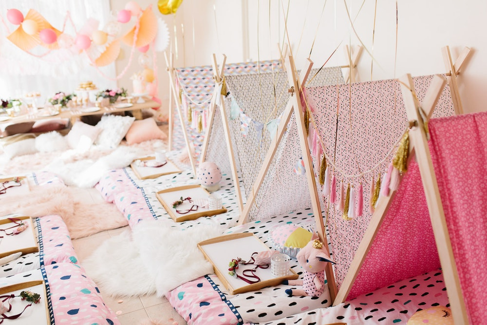 boho slumber party, peach pinch and white slumber party, pretty girl's party, glamping party, gorgeous slumber party, slumber party ideas, pink peach white party tassel feather garland, fabric teepee tent slumber party, sleepover ideas, sleepover ideas, sleepover ideas
