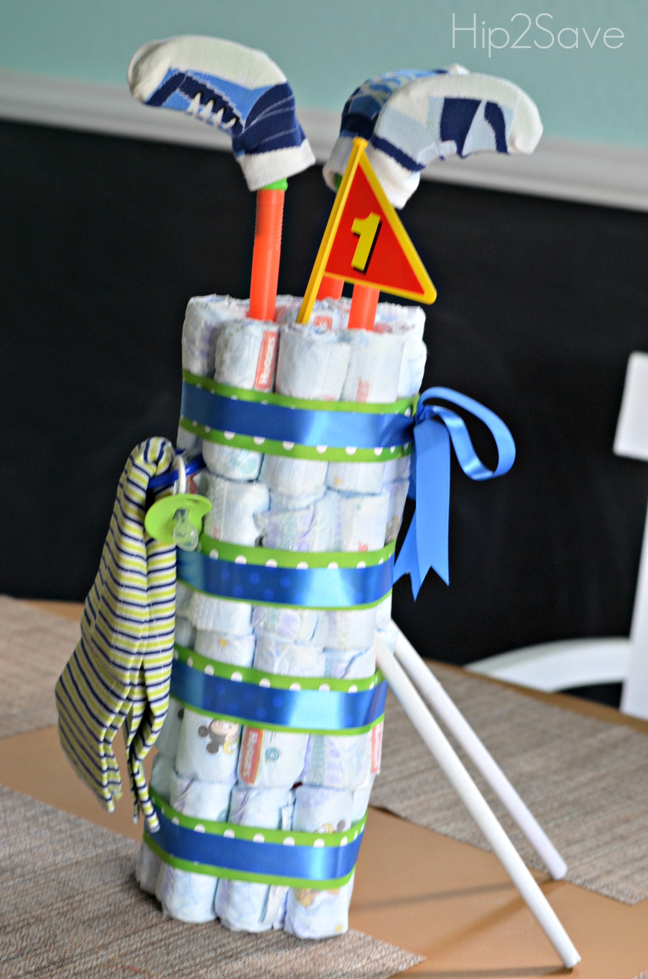 golf bag diaper cake with socks, baby shower ideas, cute baby shower, best baby shower ideas, baby shower cake, fun games for baby shower, baby shower food