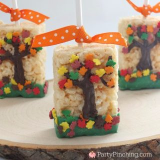 Fall autumn rice krispie treat pops, cute food, fun food for kids, tree dessert ideas, fall thanksgiving harvest dessert ideas, easy tree dessert cookie, cute fall edible crafts