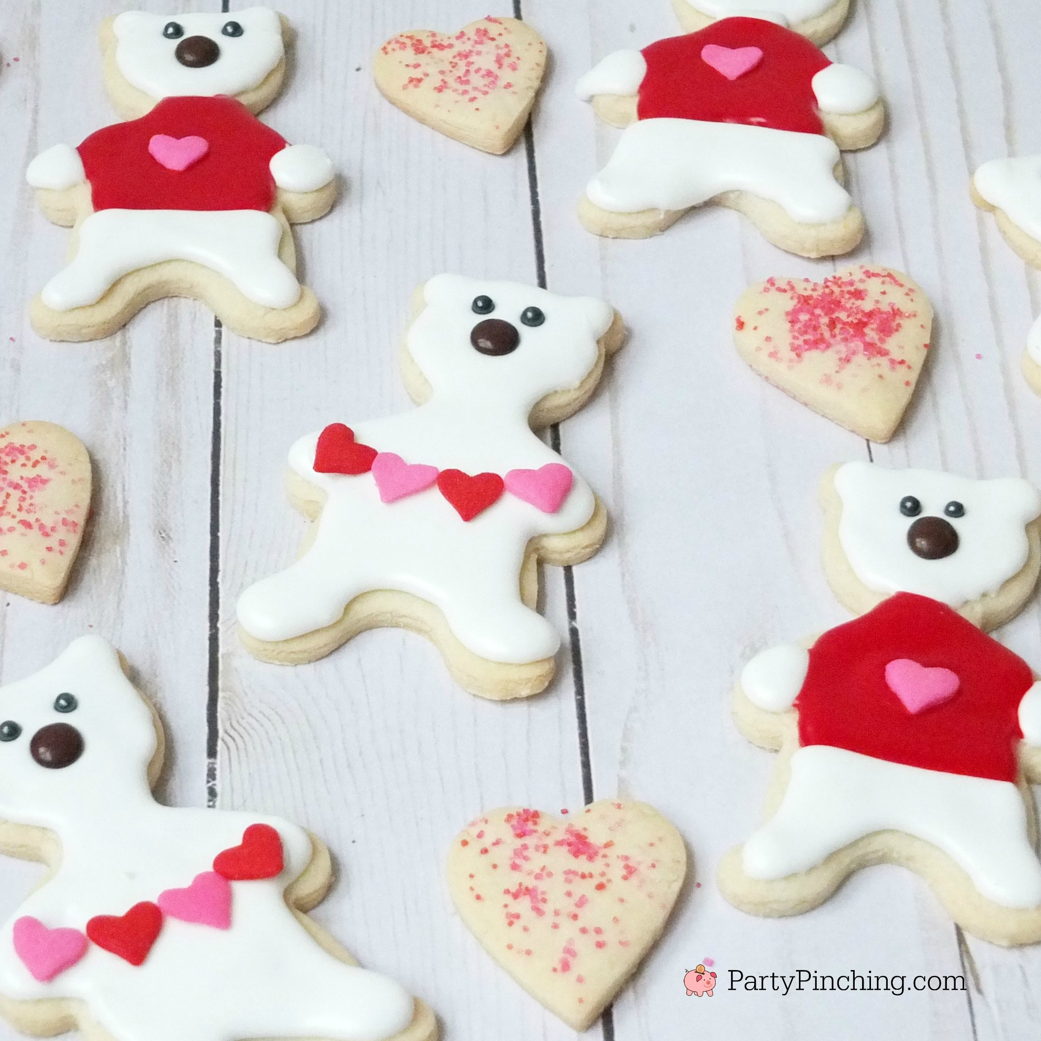 Polar bear cookies, Valentine's Day polar bear cookies, cute cookie ideas for Valentine's Day, polar bear sweater cookie, polar bear heart garland cookie, fun food for kids, cute food ideas, sweet treats