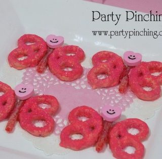 Valentine's day treats, fun food for kids, Valentine's Day classroom party ideas, cute food, Valentine's day pretzel butterfly snacks, conversation heart butterflies
