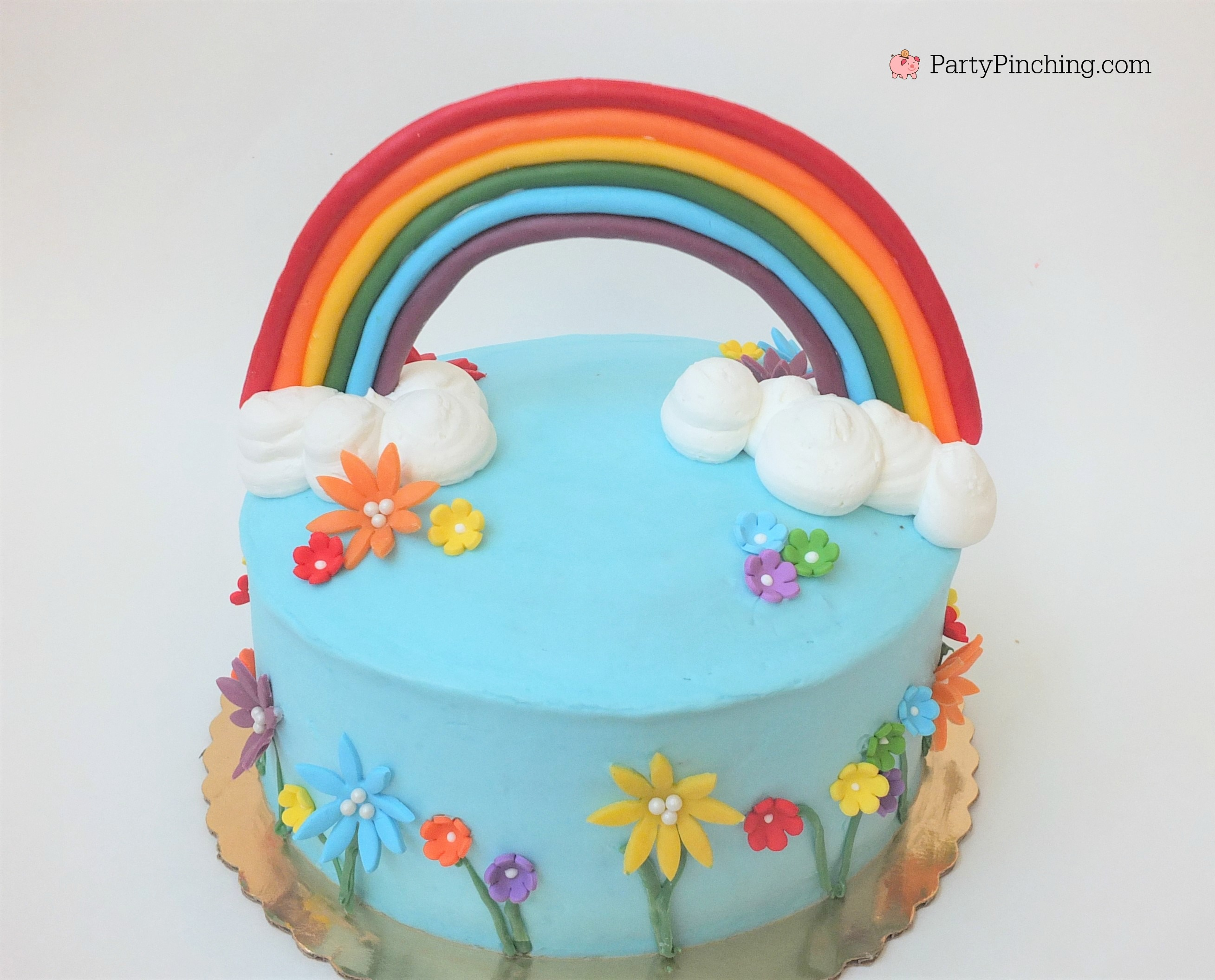 Spring Rainbow Cake With Bright Cheerful Flowers And