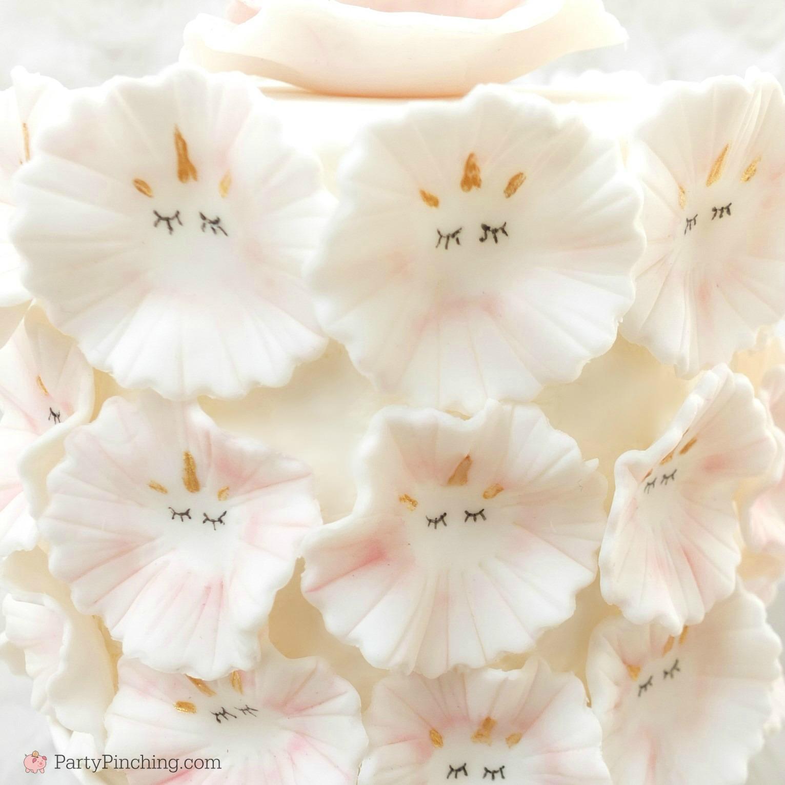fondant unicorn cake, ruffle unicorn cake, flower unicorn cake, pretty unicorn cake, beautiful gorgeous unicorn cake, pink and white unicorn cake, fluffy flower petal unicorn cake pink white