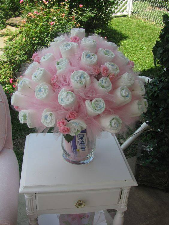 pretty DIY baby diaper rose bouquet with tulle, baby shower ideas, cute baby shower, best baby shower ideas, baby shower cake, fun games for baby shower, baby shower food