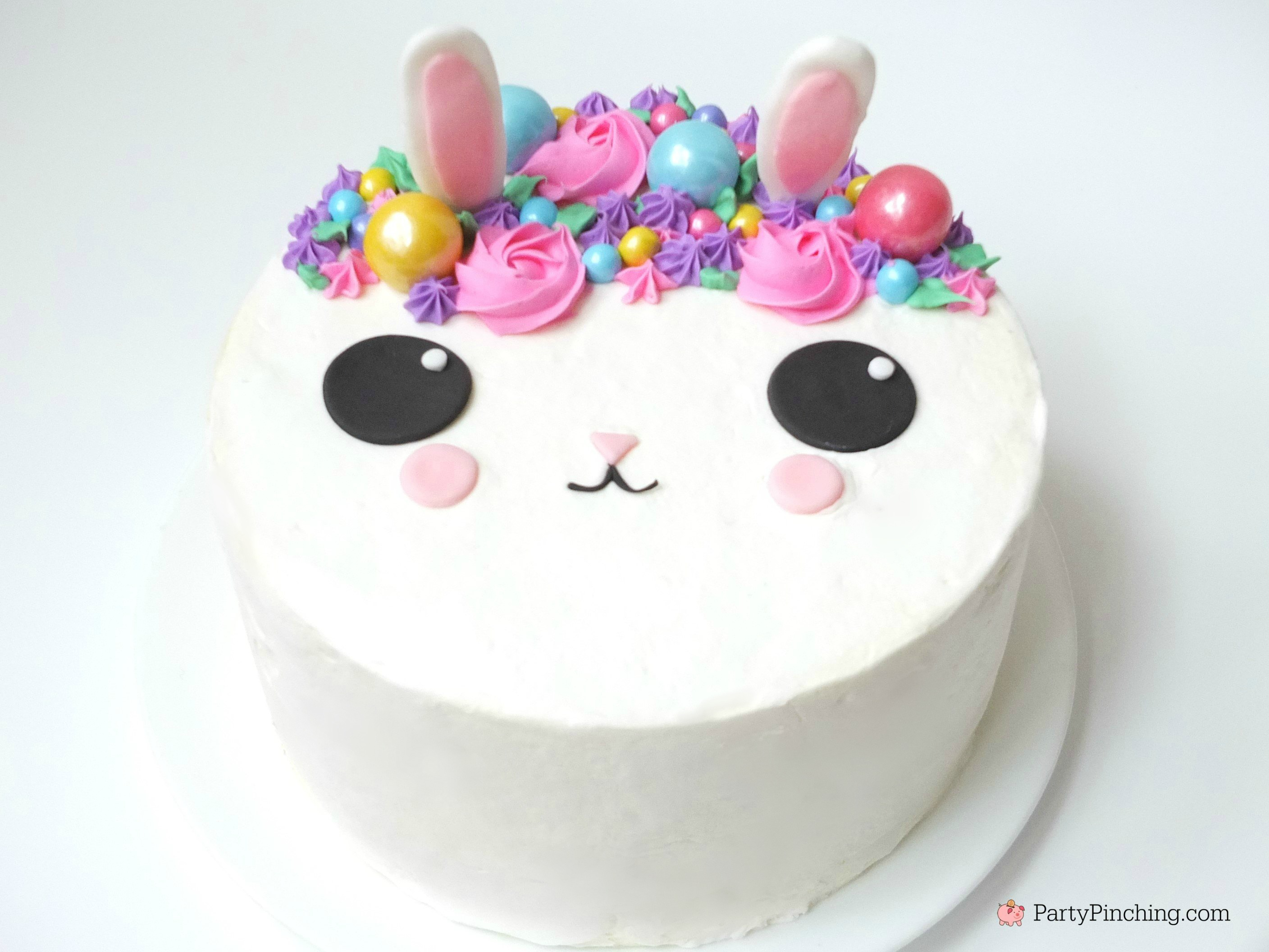 bunny cake, bunny cake with flower crown, cute kawaii bunny cake, fun easy bunny cake for Easter, sweet treats for kids, adorable rabbit cake, bunny cake with floral buttercream fondant, oreo bunny cookies, candy coated easter bunny cookies flower crown