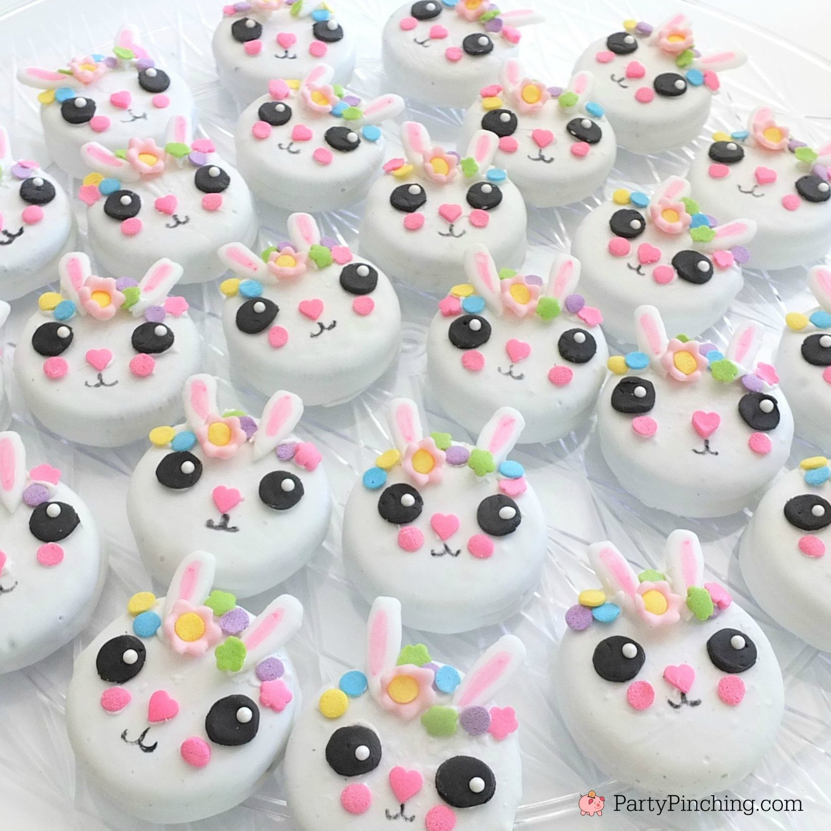 bunny oreos, bunny cookies, bunny cake, bunny cake with flower crown, cute kawaii bunny cake, fun easy bunny cake for Easter, sweet treats for kids, adorable rabbit cake, bunny cake with floral buttercream fondant, oreo bunny cookies, candy coated easter bunny cookies flower crown