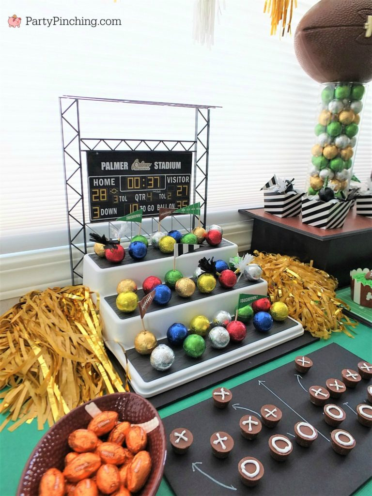 sweet snack stadium, Game time treats, football dessert ideas, football centerpiece, football dessert table, football chocolate, football cupcakes, snack stadium, food football dessert stadium, fan choclolate stadium, football game play chalk peanut butter cups, referee chocolate treats, chocolate football centerpiece, life size chocolate football, party pinching, rm palmer candy