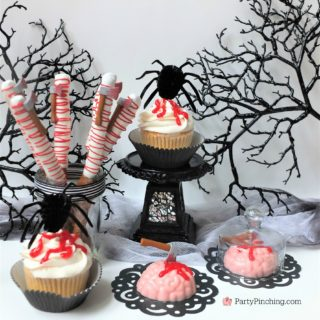 Spooky Halloween treats, creepy gross bloody dessert treats, hatchet pretzels with blood icing, spider blood cupcakes, bloody brain Oreos with candy hatchet axe