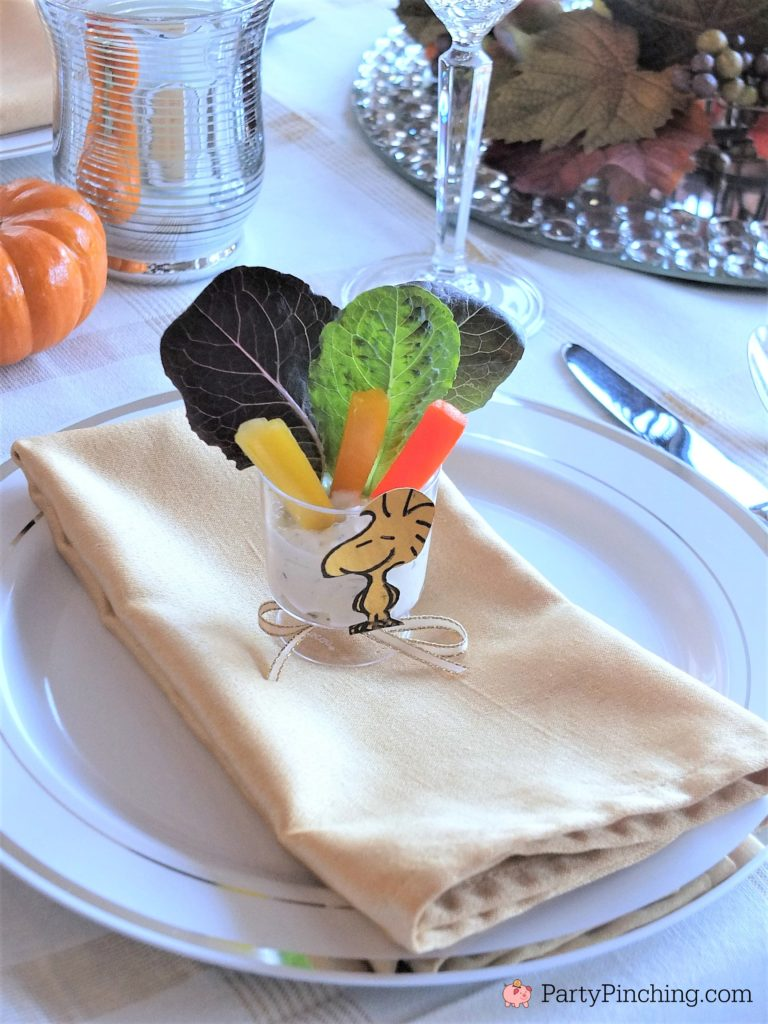 Charlie Brown Thanksgiving, Snoopy Thanksgiving, Woodstock salad appetizer Thanksgivivng table, Peanuts theme Thanksgiving dinner snack dessert ideas for kids adults, Snoopy popcorn jelly bean toast pretzel snack dinner Thanksgiving, Woodstock salad, Thanksgiving dinner table setting ideas, Thanksgiving tablescape