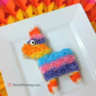 pinata rice krispie treat, fiesta cinco de mayo best recipes, best desserts for cinco de mayo fiesta party ideas, cute rice crispy pinata cookie treat coconut
