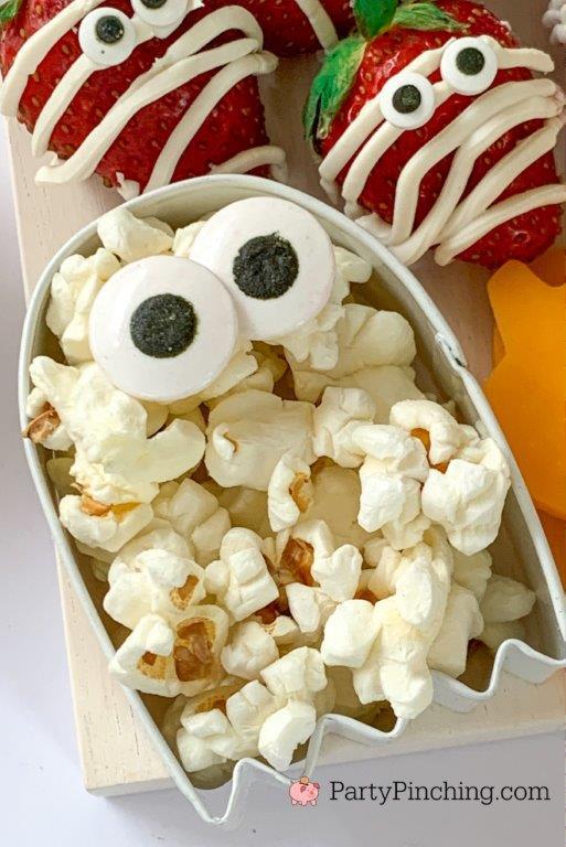 ghost cookie cutter popcorn, halloween charcuterie, spook-cuterie board, best charcuterie board ideas, easy charcuterie board, charcuterie for kids, halloween partie ideas, easy best charcuterie board ideas, healthy charcuterie board for kids