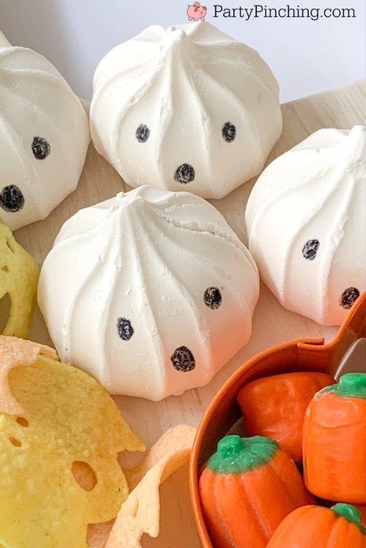 trader joe's vanilla meringue cookie ghosts, halloween charcuterie, spook-cuterie board, best charcuterie board ideas, easy charcuterie board, charcuterie for kids, halloween partie ideas, easy best charcuterie board ideas, healthy charcuterie board for kids