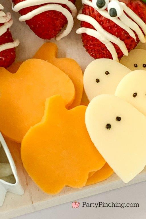 pumpkin ghost cheese, halloween charcuterie, spook-cuterie board, best charcuterie board ideas, easy charcuterie board, charcuterie for kids, halloween partie ideas, easy best charcuterie board ideas, healthy charcuterie board for kids